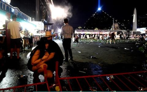 People take cover in Las Vegas - Credit: David Becker/Getty