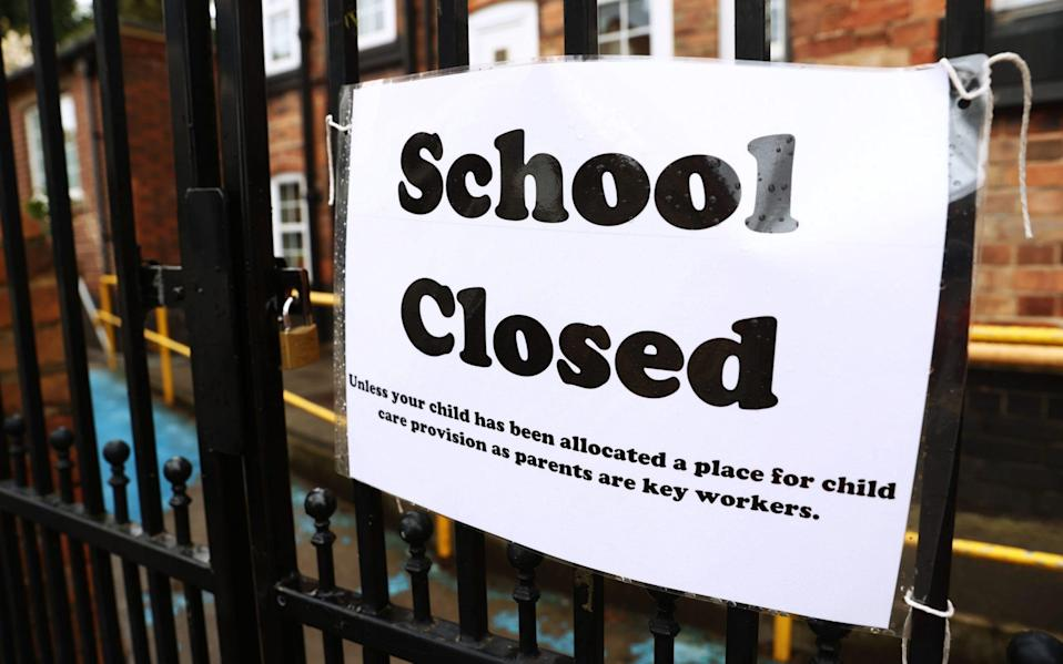 A sign outside a closed West Bridgford Infants School in Nottingham back in July - Tim Goode/PA