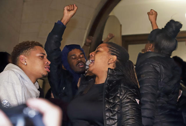 Supporters of Antwon Rose II gather on the steps of Allegheny County Courthouse after hearing the verdict of not guilty on all charges for Michael Rosfeld, a former police officer in East Pittsburgh, Pa., Friday, March 22, 2019. Rosfeld was charged with homicide in the fatal shooting of Antwon Rose II as he fled during a traffic stop on June 19, 2018. (AP Photo/Gene J. Puskar)