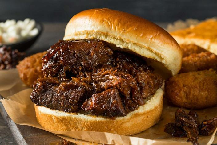 """<p><strong>Burnt End Sandwich</strong></p><p>While ribs and brisket take the spotlight in one of America's barbecue capitals, the local speciality is burnt ends. It's all about the crisp crunch at <a href=""""https://www.burntendbbq.com/"""" rel=""""nofollow noopener"""" target=""""_blank"""" data-ylk=""""slk:Burnt End BBQ"""" class=""""link rapid-noclick-resp"""">Burnt End BBQ</a>, with these charred, fattier ends from the point section of the brisket -- covered in sauce, it's irresistible. </p>"""