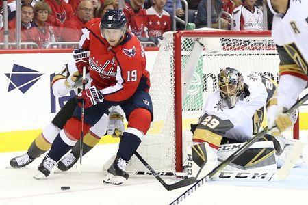 Oct 10, 2018; Washington, DC, USA; Washington Capitals center Nicklas Backstrom (19) skates with the puck behind Vegas Golden Knights goaltender Marc-Andre Fleury (29) in the first period at Capital One Arena. Mandatory Credit: Geoff Burke-USA TODAY Sports