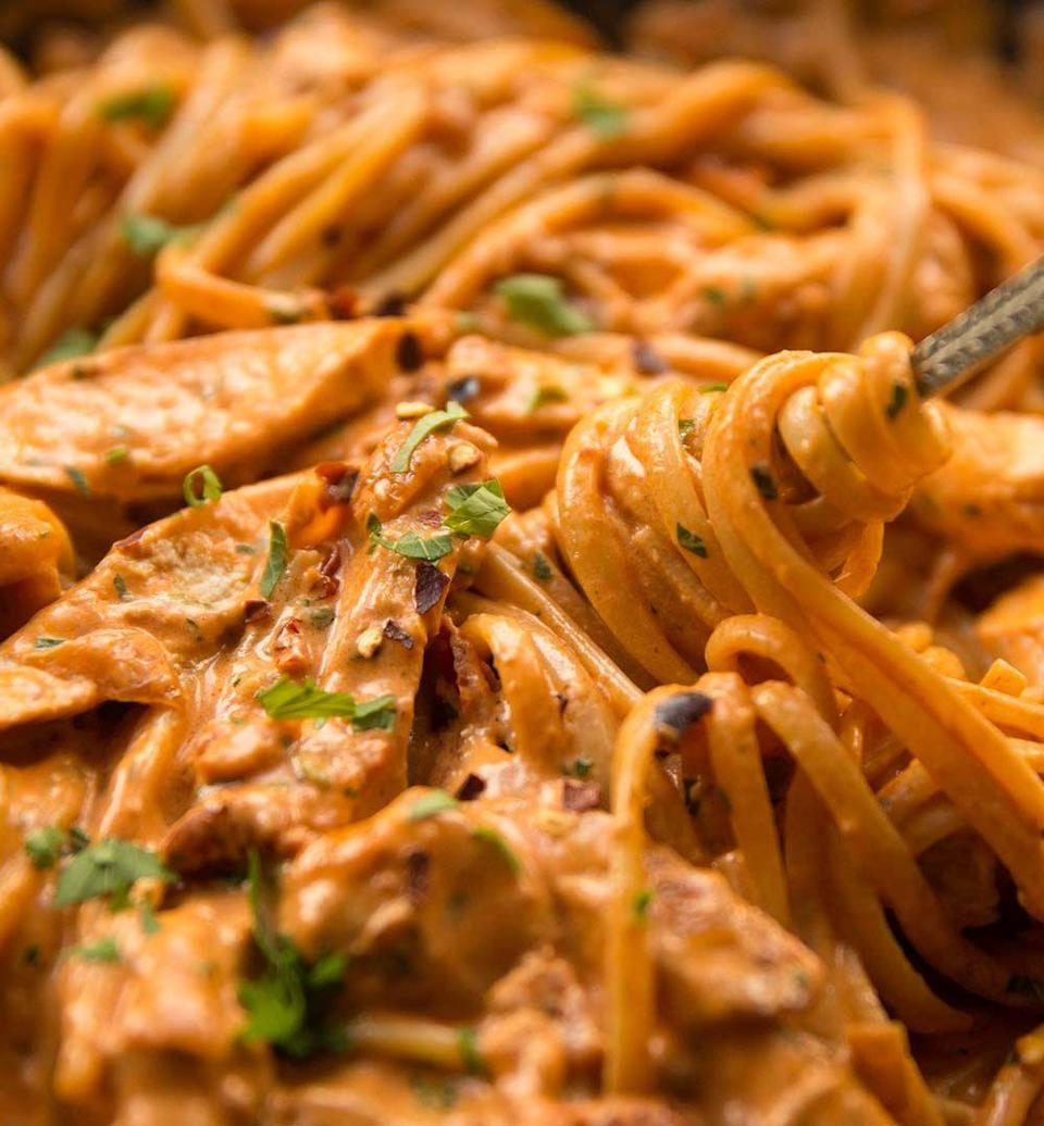 """<p>If you're looking for a """"just spicy enough"""" pasta recipe, look no further. This protein-packed, creamy dish is the ideal family meal.</p><p><strong>Get the recipe at <a href=""""https://www.dontgobaconmyheart.co.uk/spicy-chicken-pasta/"""" rel=""""nofollow noopener"""" target=""""_blank"""" data-ylk=""""slk:Don't Go Bacon My Heart"""" class=""""link rapid-noclick-resp"""">Don't Go Bacon My Heart</a>.</strong></p>"""