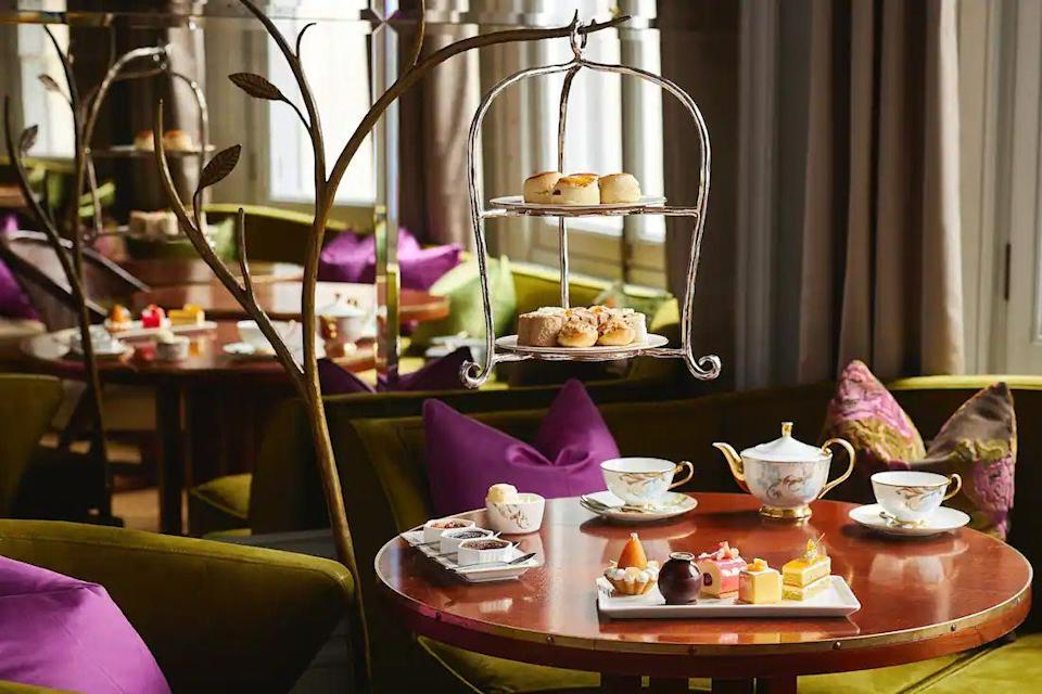 """<p>Arguably London's best hotel afternoon tea, <a href=""""https://go.redirectingat.com?id=127X1599956&url=https%3A%2F%2Fwww.booking.com%2Fhotel%2Fgb%2Fmandarin-oriental-hyde-park-london.en-gb.html%3Faid%3D2070929%26label%3Dhotel-afternoon-tea&sref=https%3A%2F%2Fwww.redonline.co.uk%2Ftravel%2Fg37102406%2Fhotel-afternoon-tea%2F"""" rel=""""nofollow noopener"""" target=""""_blank"""" data-ylk=""""slk:Mandarin Oriental Hyde Park"""" class=""""link rapid-noclick-resp"""">Mandarin Oriental Hyde Park</a>'s marvellous experience takes place in the impossibly-chic Rosebery, a backdrop that oozes elegance and glamour, which dates to the 1920s when the stylish tea room was frequented by the prime minister. The afternoon tea reflects the hotel group's oriental heritage too, with delectable sandwiches that resemble sushi. There's smoked and nori poached salmon, braised black leg chicken and Cotswold egg and black truffle among the impressive fillings. </p><p>The sandwiches are served alongside warm scones on a metal mandarin tree, again as a reminder of the hotel group's origins. Devonshire clotted cream and three different jam flavours, including rose petal jelly, accompany the scones, while the pastries are almost too pretty to eat. There's the pear tart (featuring a gold leaf finish, of course), the mango cube cake that boasts a rice pudding interior and the Japanese chiffon roll, which consists of steamed lemon biscuit, strawberry confit and Timur pepper cream. </p><p>The tea list is as extensive as you'd imagine and the tea is brought to you brewed to perfection. Earl Grey, genmaicha, White Peony - you name it, the Rosebery's tea menu has it. The highlight of afternoon tea at the Mandarin Oriental is the impeccable service for which it is renowned. The staff here will go above and beyond, bringing out plates of sandwiches until you ask them to stop, and recommending the variety of teas you should taste throughout. It's one hotel afternoon tea worth returning for.</p><p>This summer, you can also make th"""