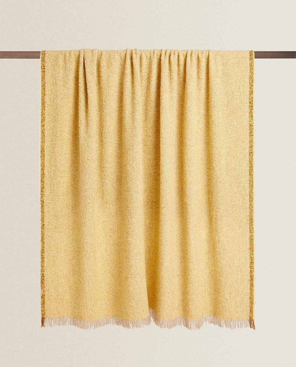 """A lockdown life without cosy wool blankets just doesn't sound bearable. Bouclé was made to shine in blanket form, as shown in this beauty from Zara Home.<br><br><strong>Zara Home</strong> Bouclé Wool Blanket, $, available at <a href=""""https://www.zarahome.com/gb/boucl%C3%A9-wool-blanket-c0p302119037.html?srch=true"""" rel=""""nofollow noopener"""" target=""""_blank"""" data-ylk=""""slk:Zara Home"""" class=""""link rapid-noclick-resp"""">Zara Home</a>"""