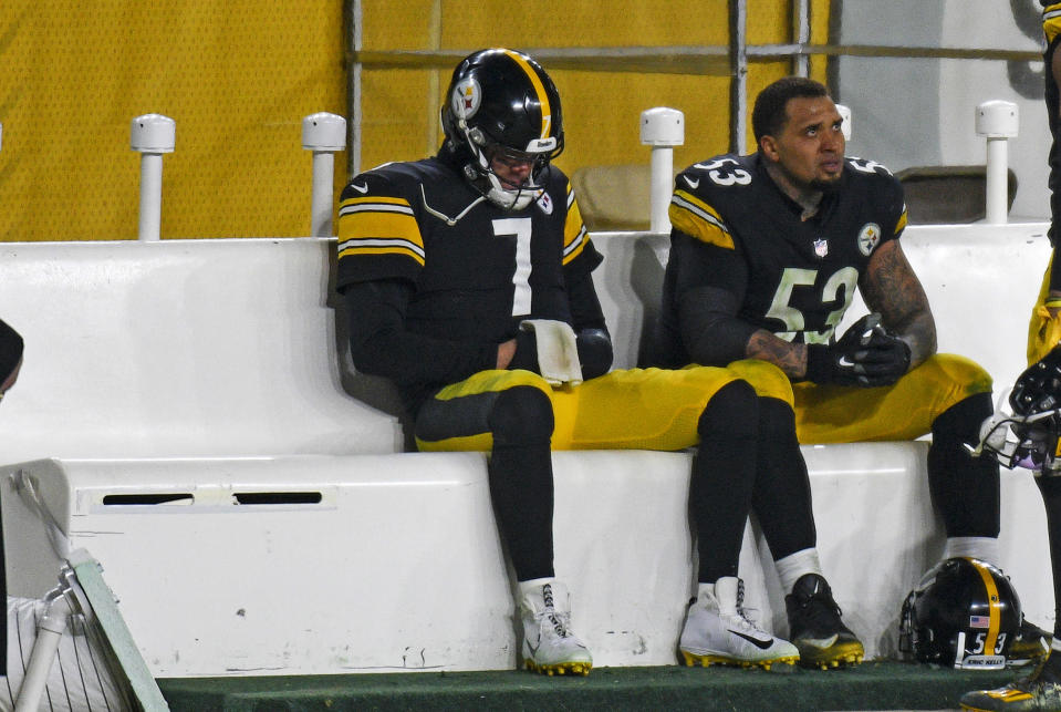 Pittsburgh Steelers quarterback Ben Roethlisberger (7) sits on the bench next to center Maurkice Pouncey (53) following a 48-37 loss to the Cleveland Browns in an NFL wild-card playoff football game in Pittsburgh, Sunday, Jan. 10, 2021. (AP Photo/Don Wright)