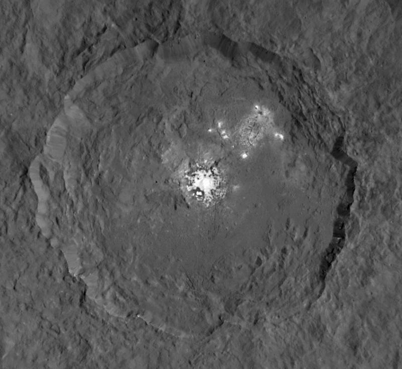 Ceres Occator crater -- photographed by the Dawn spacecraft -- is 57 miles across and 25 miles deep and includes very bright surface areas that scientists suggest may be caused by volcanic activity, icy origins or salt deposits.
