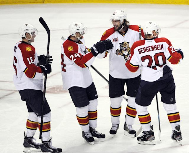 Florida Panthers' Aleksander Barkov (16) celebrates a goal by Brad Boyes (24) along with Tom Gilbert (77) and Sean Bergenheim (20) during the third period of an NHL hockey game against the Buffalo Sabres in Buffalo, N.Y., Thursday, Jan. 9, 2014. Florida won 2-1 in a shootout. (AP Photo/Gary Wiepert)