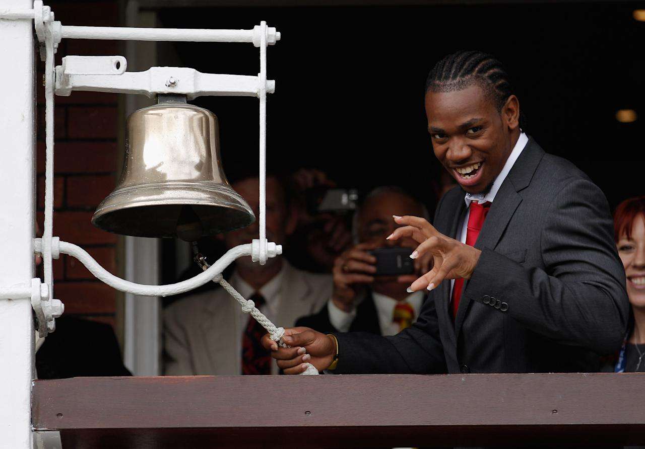 LONDON, ENGLAND - AUGUST 16: Jamaican sprinter Yohan Blake poses for photographers before ringing the bell at the start of play during day one of the 3rd Investec Test match between England and South Africa at Lord's Cricket Ground on August 16, 2012 in London, England.  (Photo by Harry Engels/Getty Images)