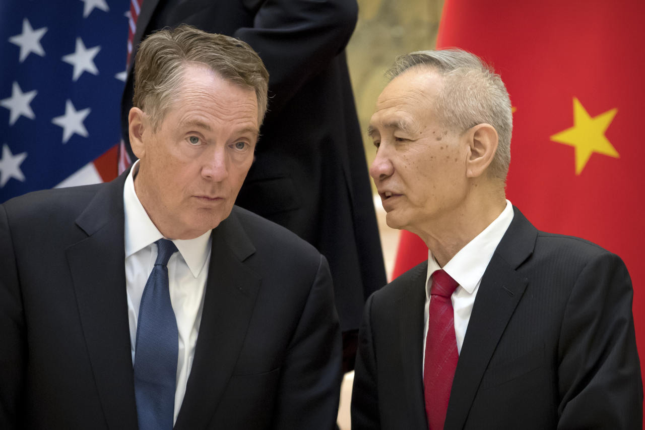 <p> FILE - In this Feb. 15, 2019, file photo, Chinese Vice Premier Liu He, right, talks with U.S. Trade Representative Robert Lighthizer, while they line up for a group photo at the Diaoyutai State Guesthouse in Beijing. China's economy czar is going to Washington for talks Thursday and Friday aimed at ending a tariff war over Beijing's technology ambitions.(AP Photo/Mark Schiefelbein, File) </p>