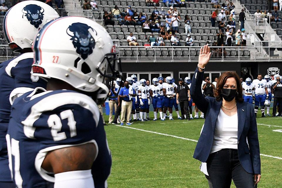 US Vice President Kamala Harris tosses the coin for the football game between Howard University and Hampton University at Audi Field in Washington, DC, on September 18, 2021.