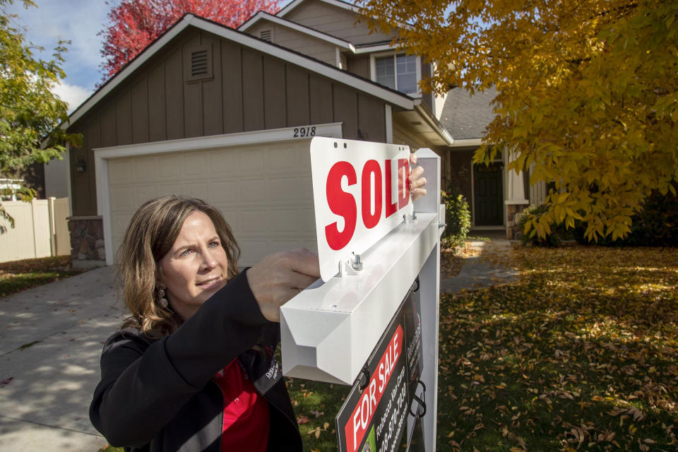 Real estate broker Rebecca Van Camp places a âEURoesoldâEUR placard on her sign in front of a home in Meridian, Idaho, on Wednesday, Oct. 21, 2020. She started Relocate208, a real estate business that caters to people moving to Idaho.  (Darin Oswald/The Idaho Statesman/Tribune News Service via Getty Images)