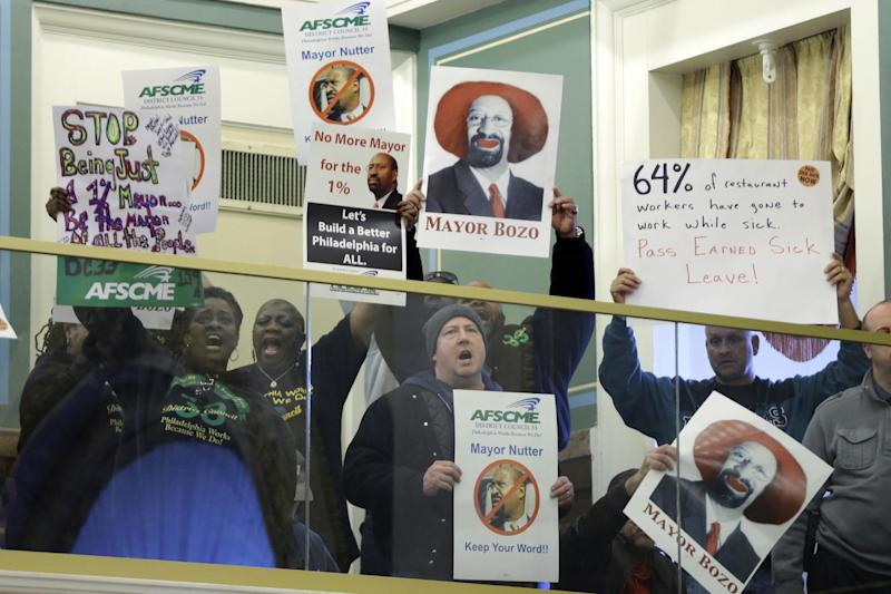 Demonstrators protest ahead of Mayor Michael Nutter's budget address to city council at City Hall, Thursday, March 14, 2013, in Philadelphia. (AP Photo/Matt Rourke)