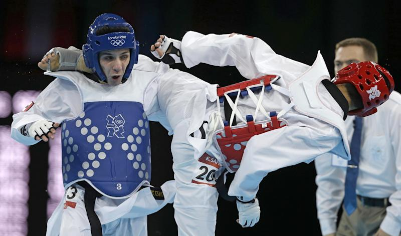Mexico's Diego Garcia de Leon fights Australia's Safwan Khalil (in red) during their match in men's 58-kg taekwondo competition at the 2012 Summer Olympics, Wednesday, Aug. 8, 2012, in London. (AP Photo/Ng Han Guan)