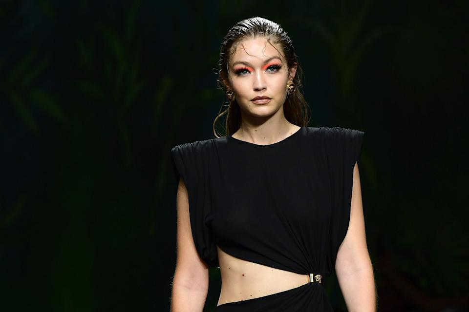 Gigi Hadid presents a creation for Versace's Women's Spring Summer 2020 collection in Milan on September 20, 2019.
