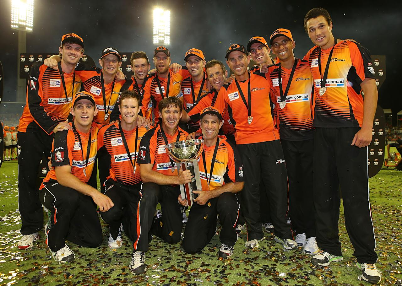 PERTH, AUSTRALIA - FEBRUARY 07:  The Scorchers celebrate winning the Big Bash League Final match between the Perth Scorchers and the Hobart Hurricanes at the WACA on February 7, 2014 in Perth, Australia.  (Photo by Paul Kane/Getty Images)