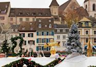 """<p><span class=""""redactor-unlink"""">Life-sized advent windows</span> have become annual traditions in some Swiss towns. Houses <a href=""""https://www.housebeautiful.com/lifestyle/g13788630/vintage-christmas-decorations-trends/"""" rel=""""nofollow noopener"""" target=""""_blank"""" data-ylk=""""slk:take turns decorating"""" class=""""link rapid-noclick-resp"""">take turns decorating</a> one of their windows each day leading up to Christmas and when your house's day comes up, you're expected to host a party for the villagers.</p>"""