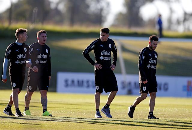 Football Soccer - Uruguay's national soccer team training - World Cup 2018 - Montevideo, Uruguay - May 22, 2018 - Uruguay's players Guillermo Varela, Christian Rodriguez, Jose Maria Gimenez and Nahitan Nandez attend a training session. REUTERS/Andres Stapff