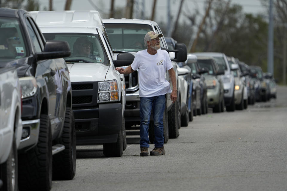 In the aftermath of Hurricane Ida, cars line up up for gas Tuesday, Aug. 31, 2021, in Houma, La. (AP Photo/David J. Phillip)