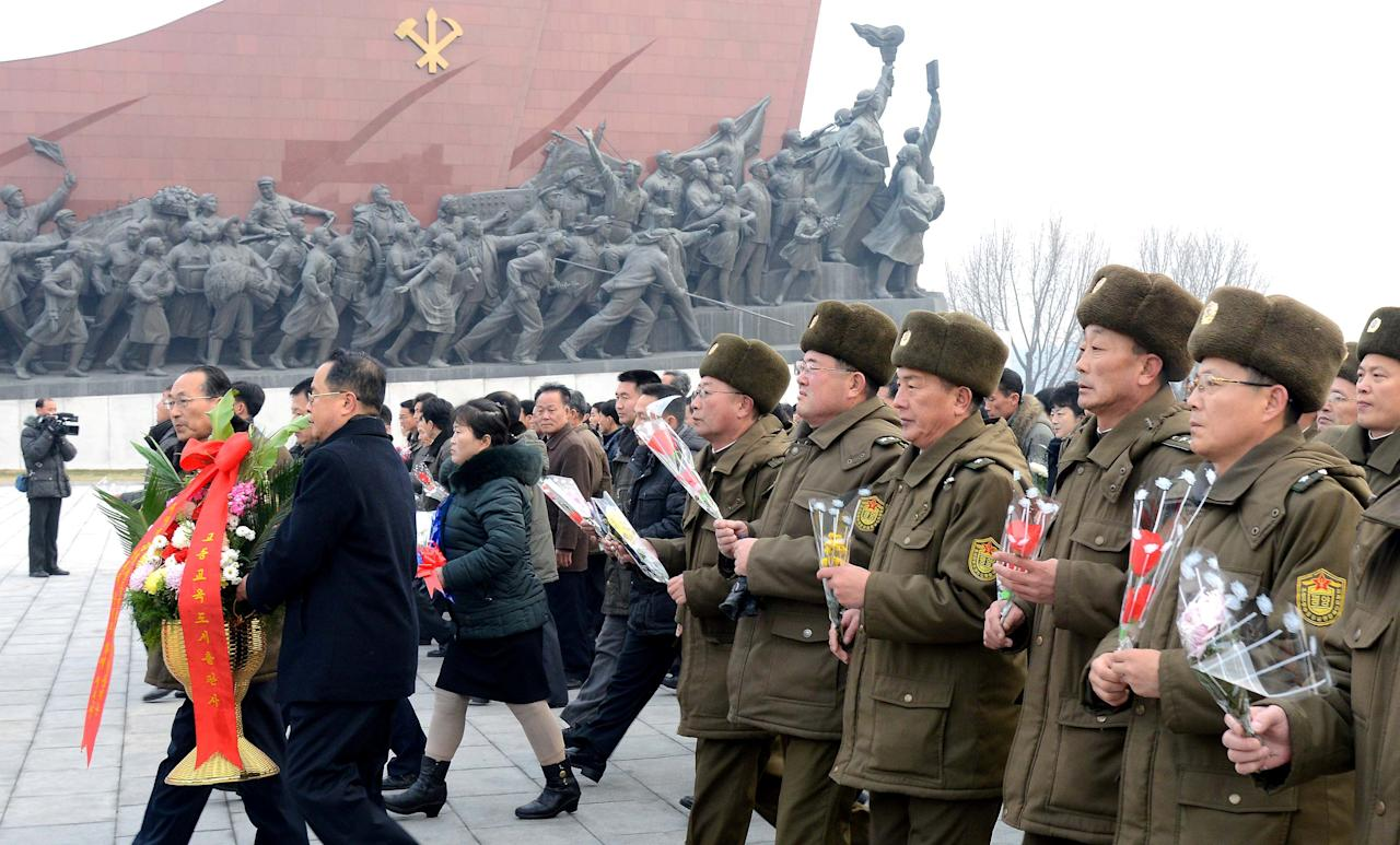 Service personnel and civilians lay flowers before the bronze statue of leader Kim Jong Il on New Year's Day in this photo released by North Korea's Korean Central News Agency (KCNA) in Pyongyang January 1, 2017. REUTERS/KCNA   ATTENTION EDITORS - THIS PICTURE WAS PROVIDED BY A THIRD PARTY. REUTERS IS UNABLE TO INDEPENDENTLY VERIFY THE AUTHENTICITY, CONTENT, LOCATION OR DATE OF THIS IMAGE. FOR EDITORIAL USE ONLY. NOT FOR SALE FOR MARKETING OR ADVERTISING CAMPAIGNS. NO THIRD PARTY SALES. NOT FOR USE BY REUTERS THIRD PARTY DISTRIBUTORS. SOUTH KOREA OUT. NO COMMERCIAL OR EDITORIAL SALES IN SOUTH KOREA. THIS PICTURE IS DISTRIBUTED EXACTLY AS RECEIVED BY REUTERS, AS A SERVICE TO CLIENTS.