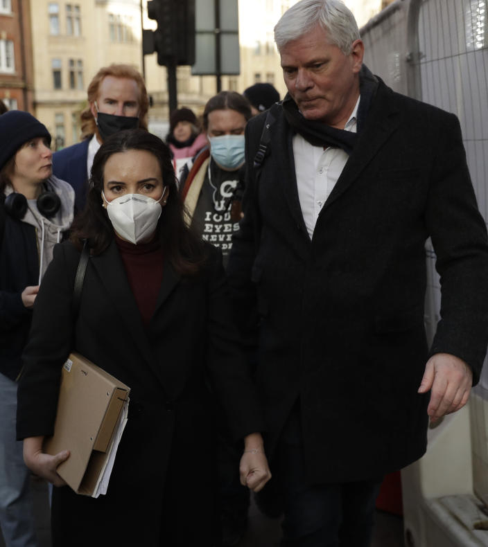 """Stella Moris girlfriend of Julian Assange, left, with Wikileaks spokesman Kristinn Hrafnsson, leave Westminster Magistrates Court after Assange was denied bail at a hearing in the court, in London, Wednesday, Jan. 6, 2021. On Monday Judge Vanessa Baraitser ruled that Julian Assange cannot be extradited to the US. because of concerns about his mental health. Assange had been charged under the US's 1917 Espionage Act for """"unlawfully obtaining and disclosing classified documents related to the national defence"""". Assange is still in custody. (AP Photo/Matt Dunham)"""