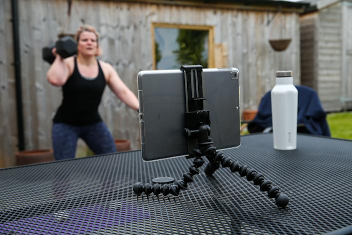 A fitness enthusiast continues to workout at home with the help of an online class. (Barrington Coombs/EMPICS Entertainment/PA Images)