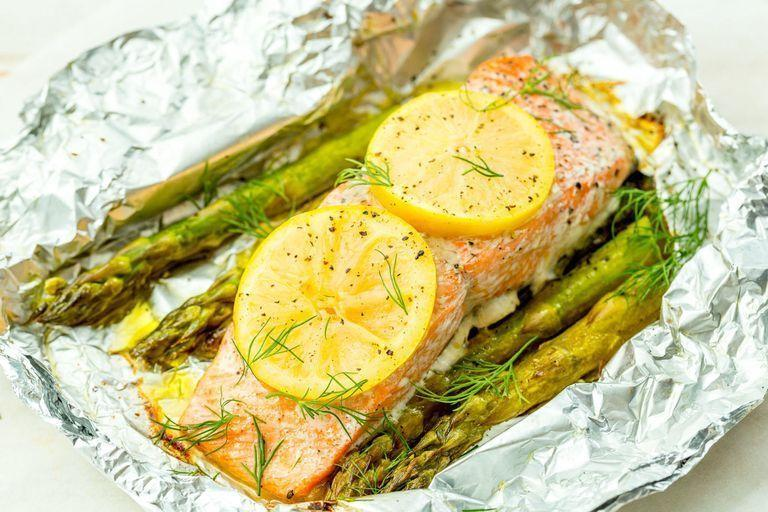 """<p>These super-fresh salmon grill packs make clean-up a breeze.</p><p>Get the <a href=""""https://www.delish.com/uk/cooking/recipes/a29205113/foil-pack-grilled-salmon-with-lemony-asparagus-recipe/"""" rel=""""nofollow noopener"""" target=""""_blank"""" data-ylk=""""slk:Foil Pack Grilled Salmon with Lemony Asparagus"""" class=""""link rapid-noclick-resp"""">Foil Pack Grilled Salmon with Lemony Asparagus</a> recipe.</p>"""