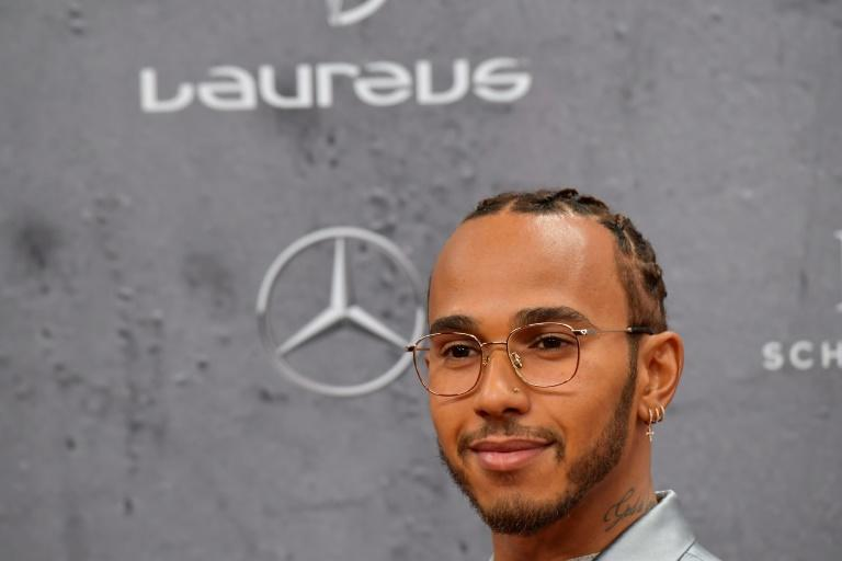 Lewis Hamilton won the joint Laureus world sportsman of the year award on Monday in Berlin alongside footballer Lionel Messi. (AFP Photo/Tobias SCHWARZ)
