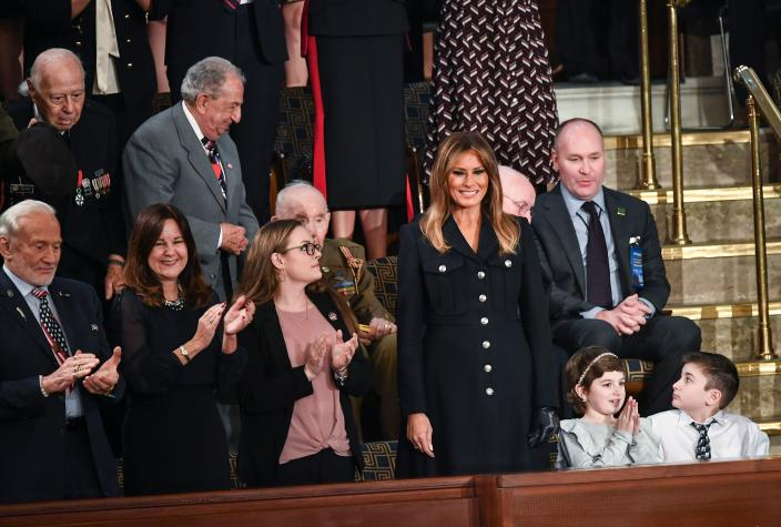 Melania Trump is surrounded by special guests of the president, including Buzz Aldrin at left, as she arrives at the State of the Union. (Photo: Mandel Ngan/AFP/Getty Images)