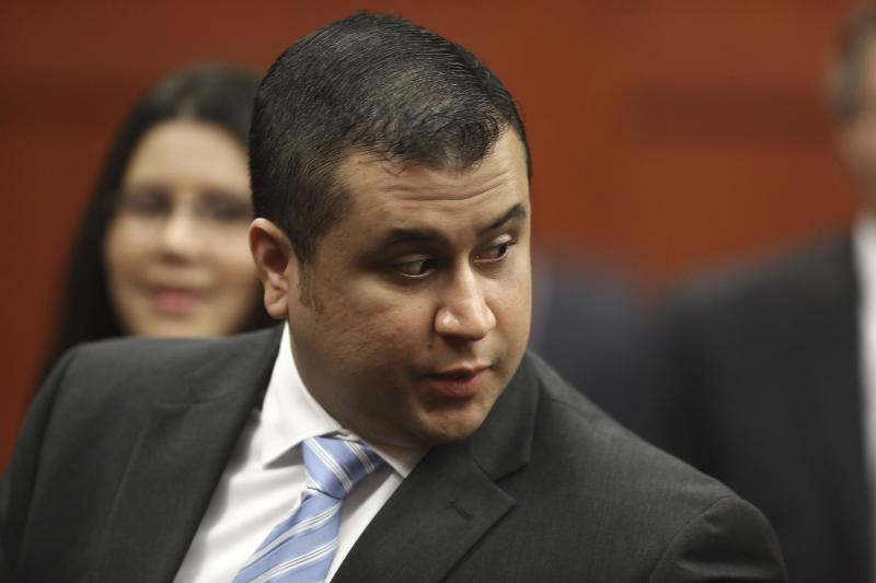 """In this Monday, July 1, 2013 photo, George Zimmerman enters the Seminole County Courthouse, in Sanford, Fla., during his trial on second degree murder for the killing of Trayvon Martin. Whether they think he got away with murdering 17-year-old Trayvon Martin or that he was just a brave neighborhood watch volunteer """"standing his ground,"""" many Americans can't seem to get enough of George Zimmerman. And he can't seem to stop giving it to them. (AP Photo/Orlando Sentinel, Joe Burbank, Pool)"""