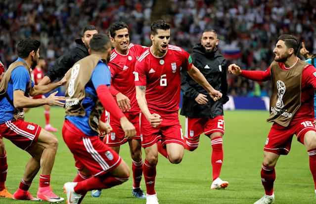 Soccer Football - World Cup - Group B - Iran vs Spain - Kazan Arena, Kazan, Russia - June 20, 2018 Iran's Saeid Ezatolahi celebrates scoring their first goal with team mates before it was disallowed after a VAR review REUTERS/Toru Hanai TPX IMAGES OF THE DAY