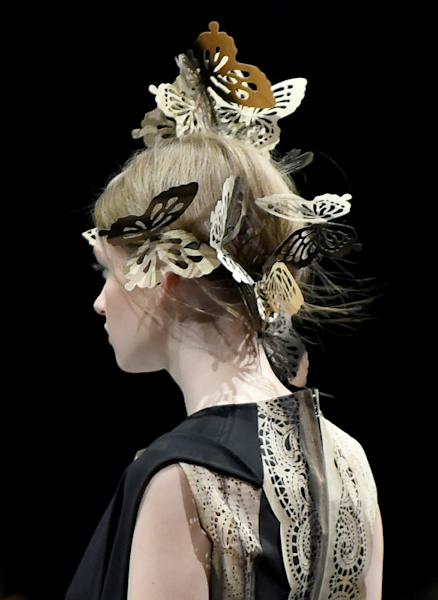 Wood was fashioned into sleeve ties and delicate butterfly hair pieces at the Hanae Mori Manuscrit show during Tokyo Fashion Week