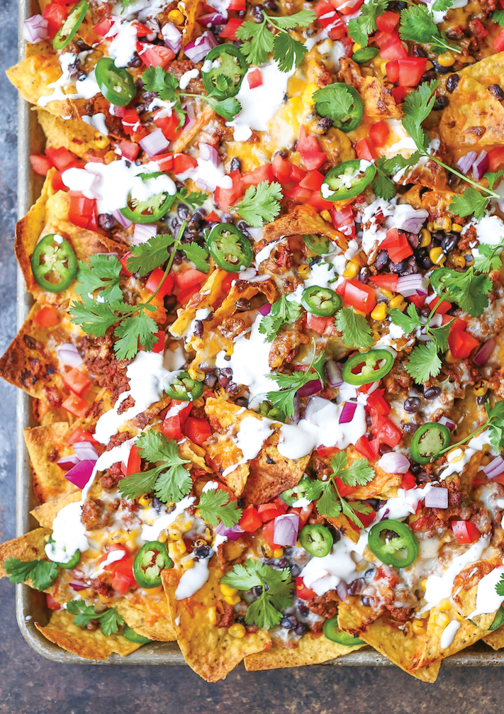 "<p>You've probably been making some form of nachos since college, but this recipe is the ultimate. Go ahead and eat it right off the pan. We won't judge.</p><p><em><a href=""http://damndelicious.net/2016/09/06/sheet-pan-nachos/"" rel=""nofollow noopener"" target=""_blank"" data-ylk=""slk:Get the recipe from Damn Delicious »"" class=""link rapid-noclick-resp""><span class=""redactor-invisible-space"">Get the recipe from Damn Delicious »</span></a></em></p>"