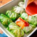 """<p>Skeptical about cabbage? You might be surprised how well it melds with the other flavours. We're fans!</p><p>Get the <a href=""""https://www.delish.com/uk/cooking/recipes/a34959492/low-carb-cabbage-enchilada-recipe/"""" rel=""""nofollow noopener"""" target=""""_blank"""" data-ylk=""""slk:Cabbage Enchiladas"""" class=""""link rapid-noclick-resp"""">Cabbage Enchiladas</a> recipe.</p>"""