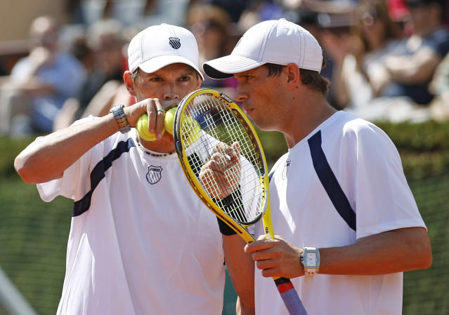 U.S. players Mike Bryan and Bob Bryan exchange words during their double match against French pair Michael Llodra and Julien Benneteau, in the quarterfinal of the Davis Cup between France and U.S. in Monaco Saturday April 7, 2012. The U.S. pair won the match. The U.S. team leads the competition 2-1 at the end of the second day.(AP Photo/Remy de la Mauviniere)