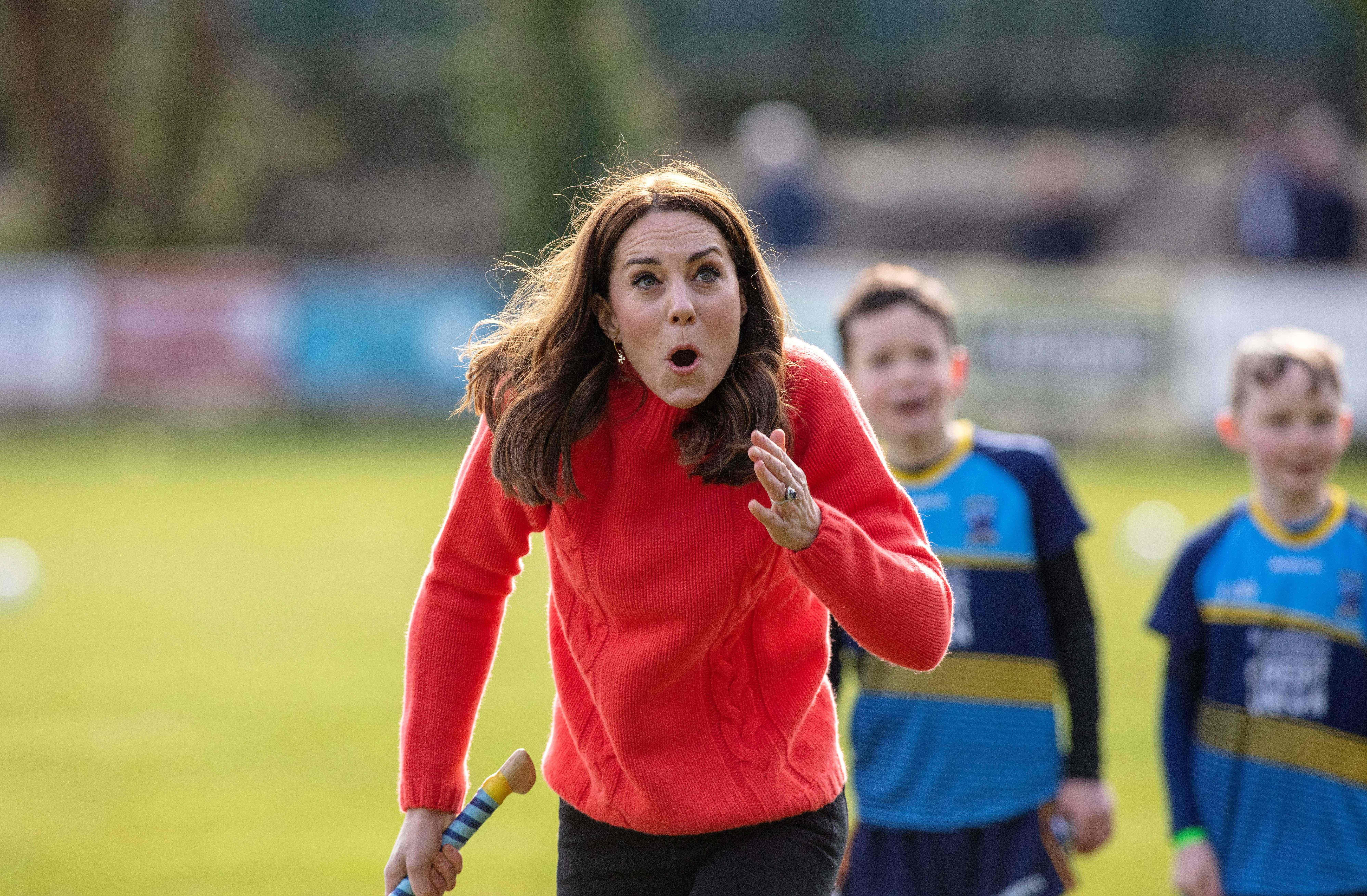 Britain's Catherine, Duchess of Cambridge, reacts after hitting the ball whilst attempting to play hurling during a visit to Salthill Gaelic Athletic Association (GAA) club in Galway, western Ireland, on March 5, 2020 on the final day of their three day visit. (Photo by Paul Faith / AFP) (Photo by PAUL FAITH/AFP via Getty Images)