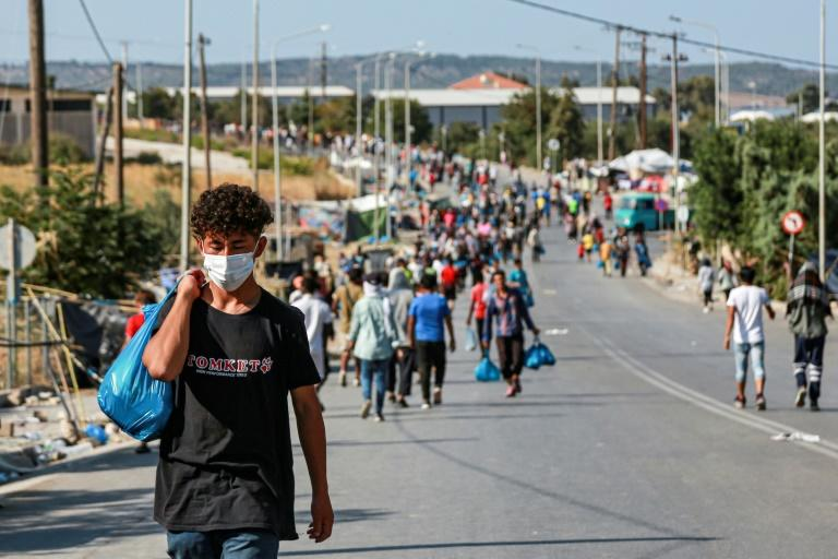 Most homeless Lesbos migrants head to new camp after fire