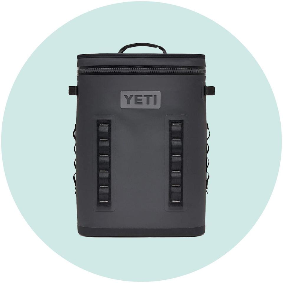 """<p><strong>YETI</strong></p><p>amazon.com</p><p><a href=""""https://www.amazon.com/dp/B07P6RXBQP?tag=syn-yahoo-20&ascsubtag=%5Bartid%7C10055.g.34470155%5Bsrc%7Cyahoo-us"""" rel=""""nofollow noopener"""" target=""""_blank"""" data-ylk=""""slk:Shop Now"""" class=""""link rapid-noclick-resp"""">Shop Now</a></p><p>Cool drinks are a must on road trips and hikes. Show your partner you've got his back with this Yeti backpack cooler. It's big enough to hold 20 cans—more than enough beverages for you both—and has closed-cell rubber foam to keep those drinks icy cold. High-density fabric that's waterproof and resistant to mildew, punctures, and UV rays ensures this portable cooler will be used for years. </p>"""