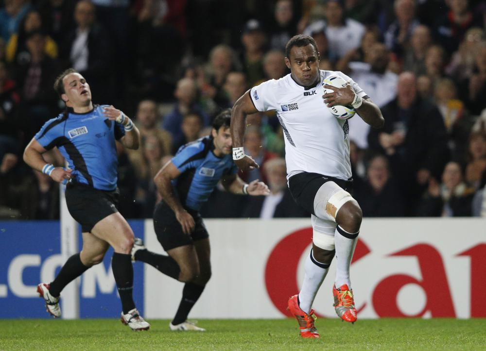 Fiji's Leone Nakarawa runs to score a try against Uruguay during the 2015 Rugby World Cup.