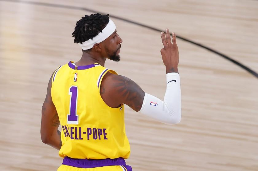 Los Angeles Lakers' Kentavious Caldwell-Pope reacts after his three-point basket during the third quarter.