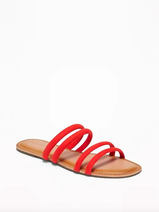 "<p>Between the bright coral color, suede texture, and unique details, these <a href=""https://www.popsugar.com/buy/sandals-476381?p_name=sandals&retailer=oldnavy.gap.com&pid=476381&price=15&evar1=fab%3Auk&evar9=46463448&evar98=https%3A%2F%2Fwww.popsugar.com%2Ffashion%2Fphoto-gallery%2F46463448%2Fimage%2F46463454%2FTubular-Faux-Suede-Sandals&prop13=api&pdata=1"" rel=""nofollow"" data-shoppable-link=""1"" target=""_blank"" class=""ga-track"" data-ga-category=""Related"" data-ga-label=""http://oldnavy.gap.com/browse/product.do?pid=409646022&amp;cid=55151&amp;pcid=55147&amp;grid=pds_59_272_1#pdp-page-content"" data-ga-action=""In-Line Links"">sandals</a> ($15, originally $20) will add visual interest to any outfit. </p>"