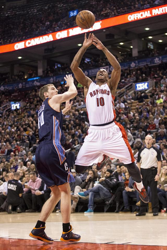 Toronto Raptors' DeMar DeRozan, right, is fouled by Charlotte Bobcats' Cody Zeller during the first half of an NBA basketball game in Toronto on Wednesday, Dec. 18, 2013. (AP Photo/The Canadian Press, Chris Young)