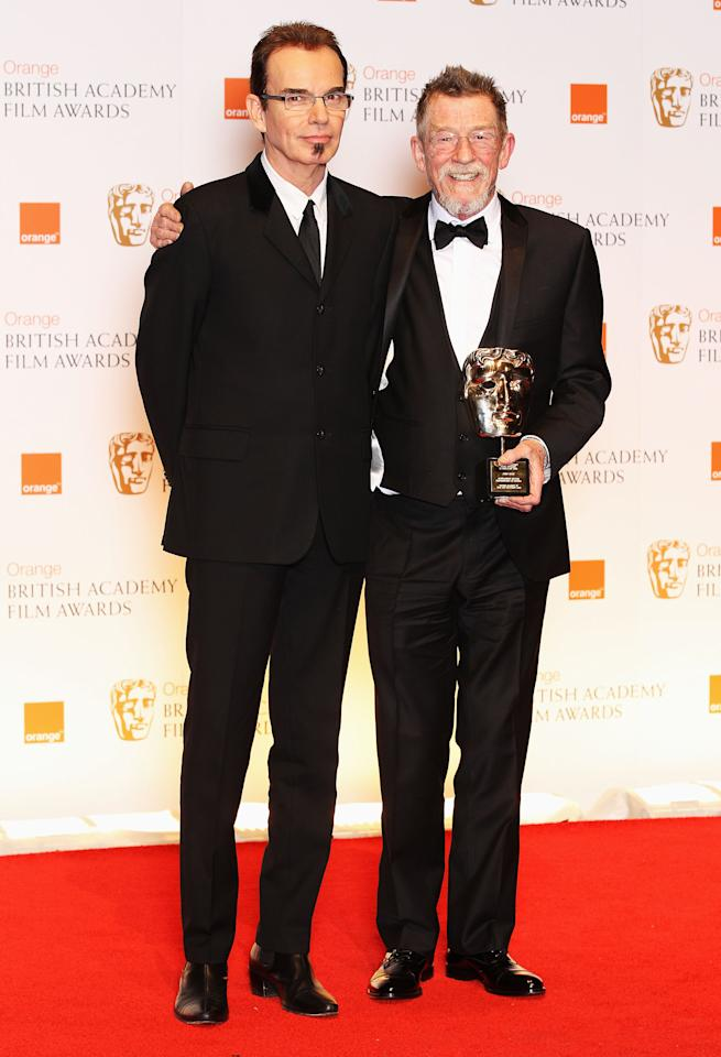 LONDON, ENGLAND - FEBRUARY 12:  Presenter Billy Bob Thornton and Actor John Hurt pose in the press room with the Oustanding British Contribution award during the Orange British Academy Film Awards 2012 at the Royal Opera House on February 12, 2012 in London, England.  (Photo by Chris Jackson/Getty Images)