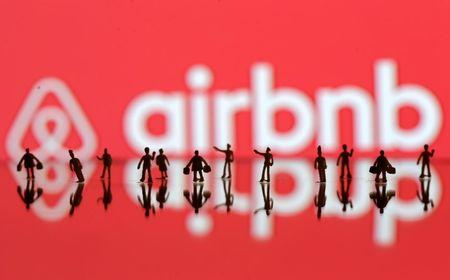 FILE PHOTO: A 3D printed people's models are seen in front of a displayed Airbnb logo in this illustration