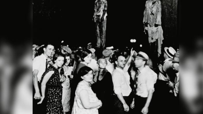 A crowd gathering to witness the killing of Thomas Shipp and Abram Smith, two victims of lynch law in Marion, Indiana