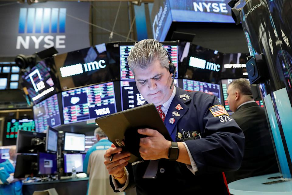 Traders work on the floor at the New York Stock Exchange (NYSE) in New York, U.S., January 8, 2020. REUTERS/Brendan McDermid