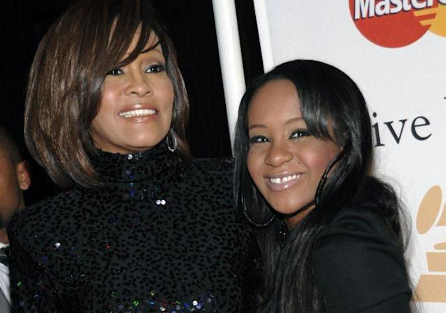 Whitney Houston with her daughter, Bobbi Kristina, at an event in 2011. (Photo: AP Images)