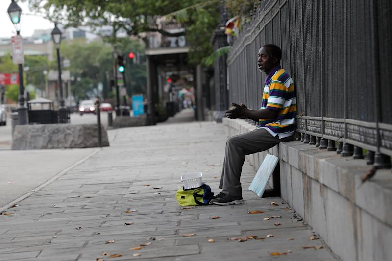 A street artist sings to no one March 27 along Jackson Square in the French Quarter of New Orleans, normally bustling with tourists but nearly deserted during the coronavirus pandemic.