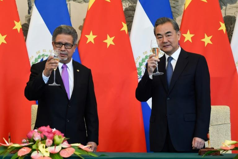 El Salvador's Foreign Minister Carlos Castaneda, left, and China's Foreign Minister Wang Yi drink a toast during a signing ceremony to establish diplomatic relations, at the Diaoyutai State Guesthouse in Beijing