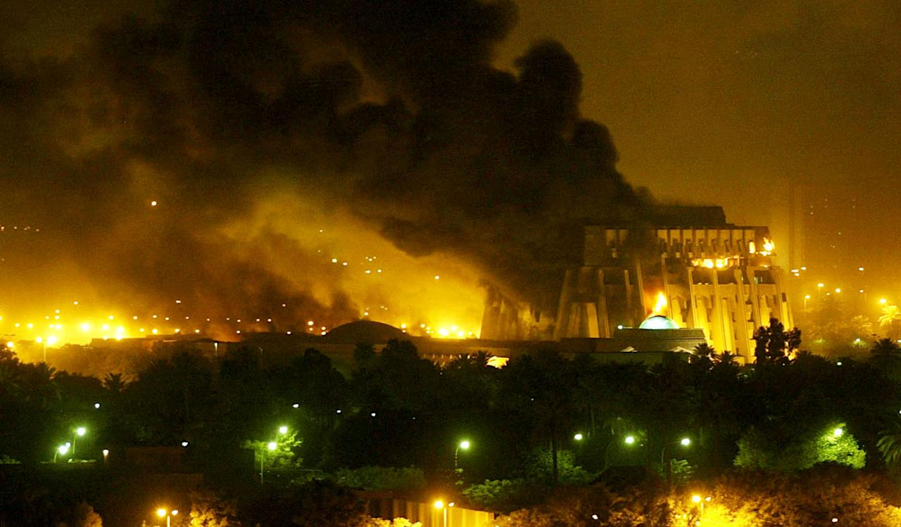 An explosion rocks Baghdad during air strikes March 21, 2003. U.S.-led forces unleashed a devastating blitz on Baghdad on Friday night, triggering giant fireballs and deafening explosions and sending huge mushroom clouds above the city centre. Missiles slammed into the main palace complex of President Saddam Hussein on the bank of the Tigris River, and key government buildings, in an onslaught that far exceeded strikes that launched the war on Thursday, Reuters correspondents said. REUTERS/Goran Tomasevic