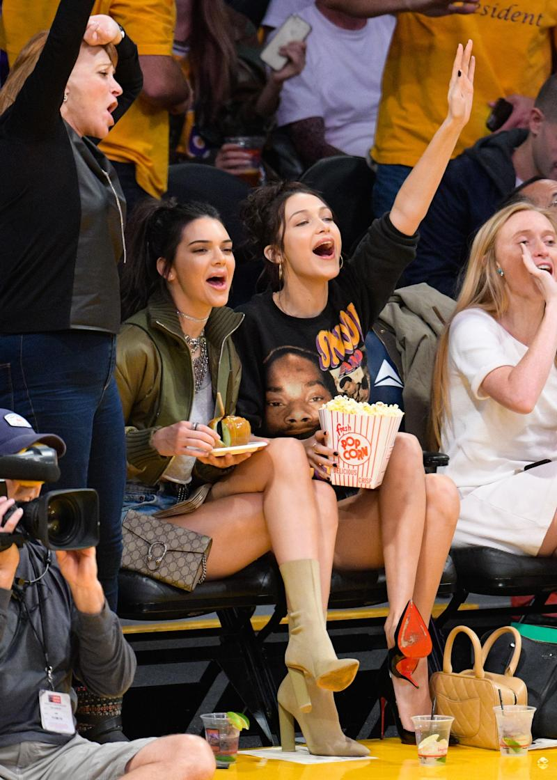 Back at it, Jenner wore a pair of nude booties to a game between the Dallas Mavericks and the Los Angeles Lakers. Her companion, Bella Hadid, chose a pair of black Christian Louboutin pumps.